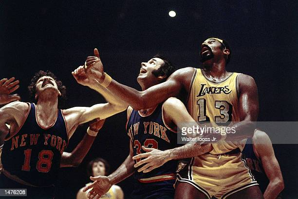 Wilt Chamberlain of the Los Angeles Lakers battles for a rebound against Jerry Lucas and Phil Jackson of the New York Knicks in Los Angeles...
