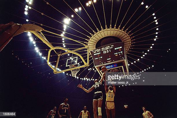 Wilt Chamberlain of the Los Angeles Lakers battles for a rebound against Kareem AbdulJabbar of the Milwaukee Bucks at the Forum in Los Angeles...