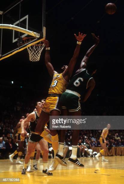 Wilt Chamberlain of the Los Angeles Lakers blocks the shot attempt by Bill Russell of the Boston Celtics during the 19711972 season at the Forum in...