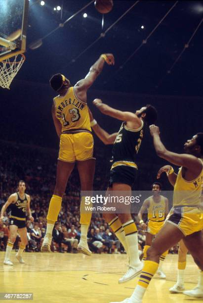 Wilt Chamberlain of the Los Angeles Lakers blocks the shot attempt by Zaid AbdulAziz of the Seattle SuperSonics during the 19711972 season at the...