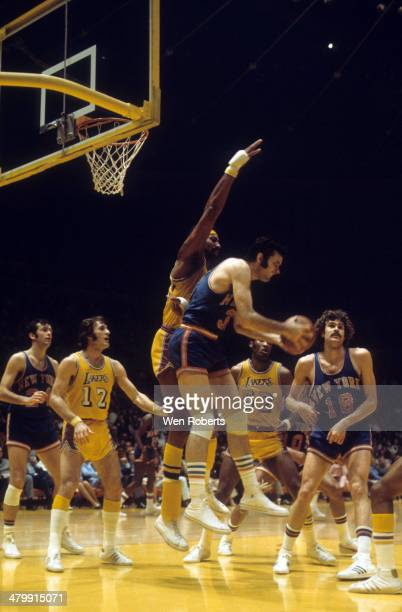 Wilt Chamberlain of the Los Angeles Lakers defends against Jerry Lucas of the New York Knicks as Pat Riley of the Lakers and Phil Jackson of the...