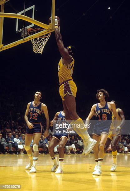 Wilt Chamberlain of the Los Angeles Lakers goes for a dunk as Jerry Lucas, Walt Frazier and Phil Jackson of the New York Knicks look on circa 1972 at...