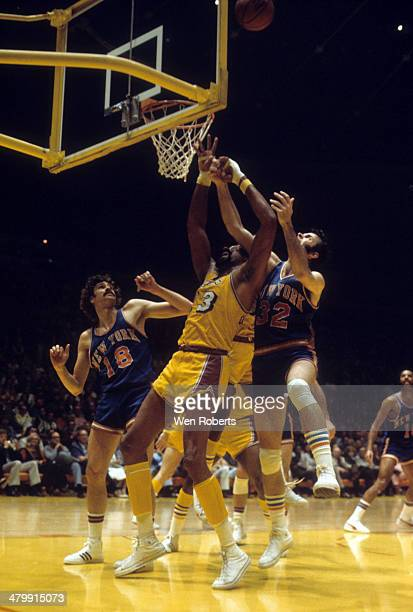 Wilt Chamberlain of the Los Angeles Lakers goes for the rebound along with Jerry Lucas and Phil Jackson of the New York Knicks circa 1972 at the...