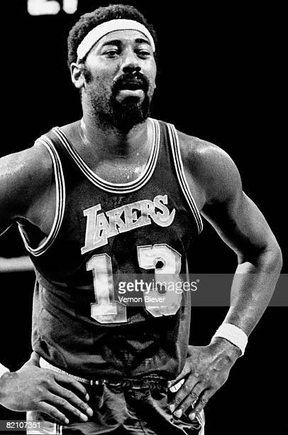 Wilt Chamberlain of the Los Angeles Lakers looks on during a game against the Milwaukee Bucks during the 1970 season at the MECCA Arena in Milwaukee...