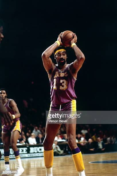 Wilt Chamberlain of the Los Angeles Lakers passes against the Milwaukee Bucks during the 1972 season at the MECCA Arena in Milwaukee Wisconsin NOTE...