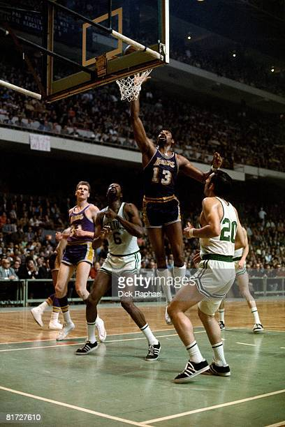 Wilt Chamberlain of the Los Angeles Lakers shoots a layup against Bill Russell of the Boston Celtics circa 1968 at the Boston Garden in Boston...