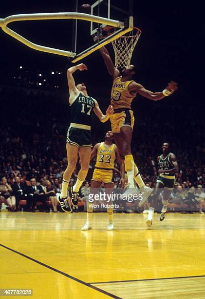 Wilt Chamberlain of the Los Angeles Lakers tries to block the shot attempt by John Havlicek of the Boston Celtics during the 19711972 season at the...