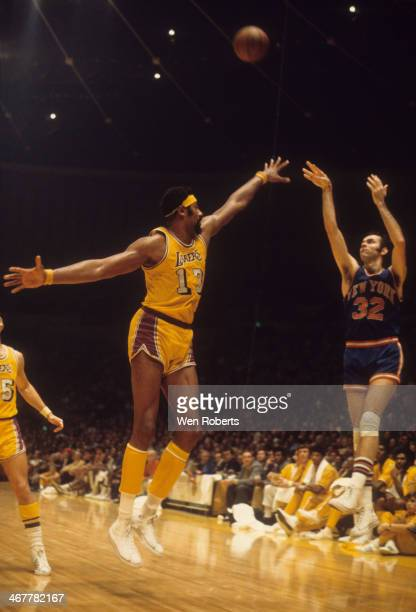 Wilt Chamberlain of the Los Angeles Lakers tries to block the shot attempt by Jerry Lucas of the New York Knicks during the 19711972 season at the...