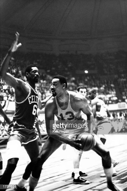 Wilt Chamberlain of the Philadelphia 76ers goes against Bill Russell of the Boston Celtics during the 1966 NBA Game in Philadelphia Pennsylvania NOTE...