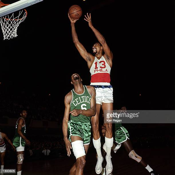 Wilt Chamberlain of the Philadelphia 76'ers goes up for a finger roll layup agaisnt Bill Russell of the Boston Celtics in 1967 during an NBA game in...