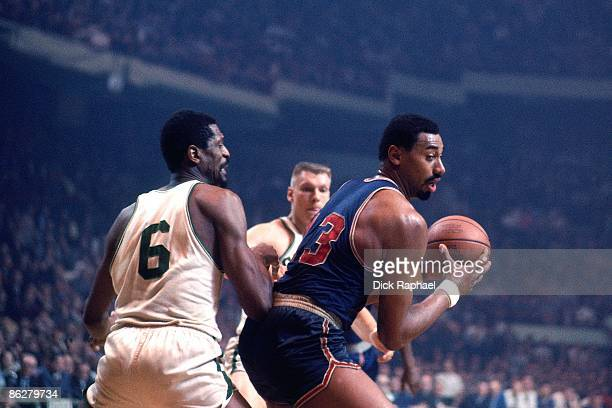 Wilt Chamberlain of the Philadelphia 76ers posts up against Bill Russell of the Boston Celtics during a game played in 1967 at the Boston Garden in...