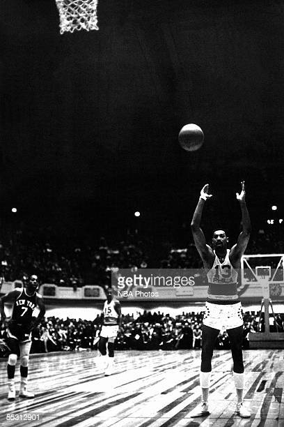 Wilt Chamberlain of the Philadelphia 76ers shoots a free throw during a 1966 NBA game against the New York Knicks at the Spectrum in Philadelphia...