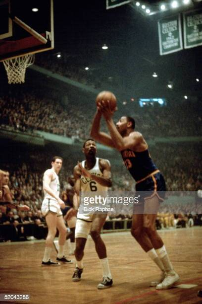 Wilt Chamberlain of the San Francisco Warriors shoots a jumpshot in the lane against Bill Russell of the Boston Celtics during an NBA game at the...
