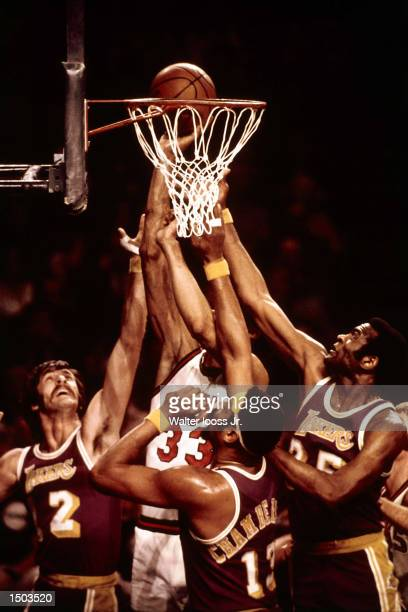 Wilt Chamberlain Pat Riley and Leroy Ellis of the Los Angeles Lakers defend against Kareem AbdulJabbar of the Milwaukee Bucks from scoring at the...