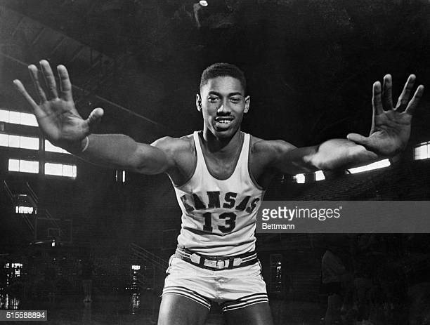 """Wilt """"The Stilt"""" Chamberlain, 7-foot Kansas Center, displays the mitts which have deflected 127 enemy shots during Kansas' first twenty games this..."""