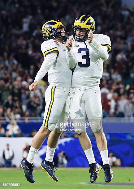 Wilton Speight and John O'Korn of the Michigan Wolverines celebrate after a twopoint conversion in the fourth quarter against the Florida State...