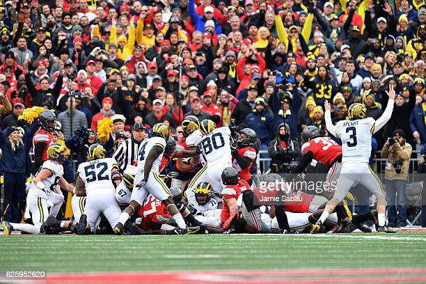 Wilton Speight of the Michigan Wolverines celebrates after a rushing touchdown by Khalid Hill of the Michigan Wolverines during the second quarter...