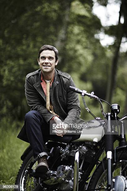 Singer Robbie Williams poses for a portrait shoot by photographer Julian Broad in Wiltshire on June 12 2009