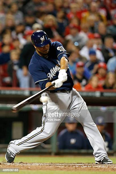 Wily Peralta of the Milwaukee Brewers swings at the ball during the game against the Cincinnati Reds at Great American Ball Park on May 2 2014 in...