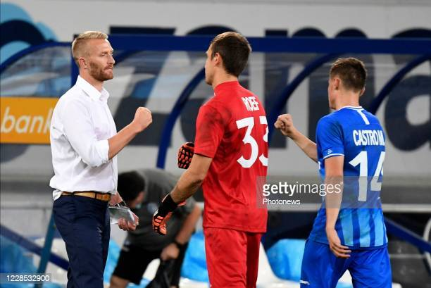 Wim De Decker coach of KAA Gent celebrates the win with his players during the UEFA Champions League third qualifying round match between KAA Gent...