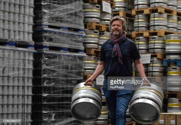Wim De Jongh, founder of Hope Brewery in Dublin, carrying kegs to be shipped to customers before pubs reopen in Ireland. Pubs and restaurants are set...