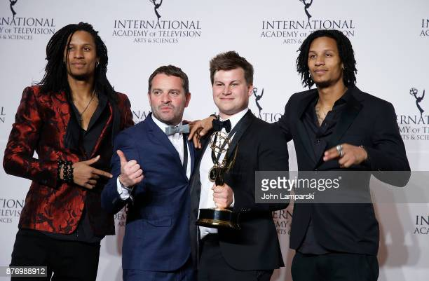 Wim Janseen and Kamiel De Bruyne pose with an award for Best NonScripted Entertainment for 'Sorry Voor Alles' with Les Twins Laurent and Larry...