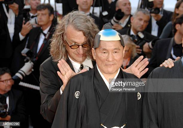 Wim Wenders and Takeshi Kitano during 2007 Cannes Film Festival 'Chacun Son Cinema' All Directors Premiere at Palais des Festival in Cannes France