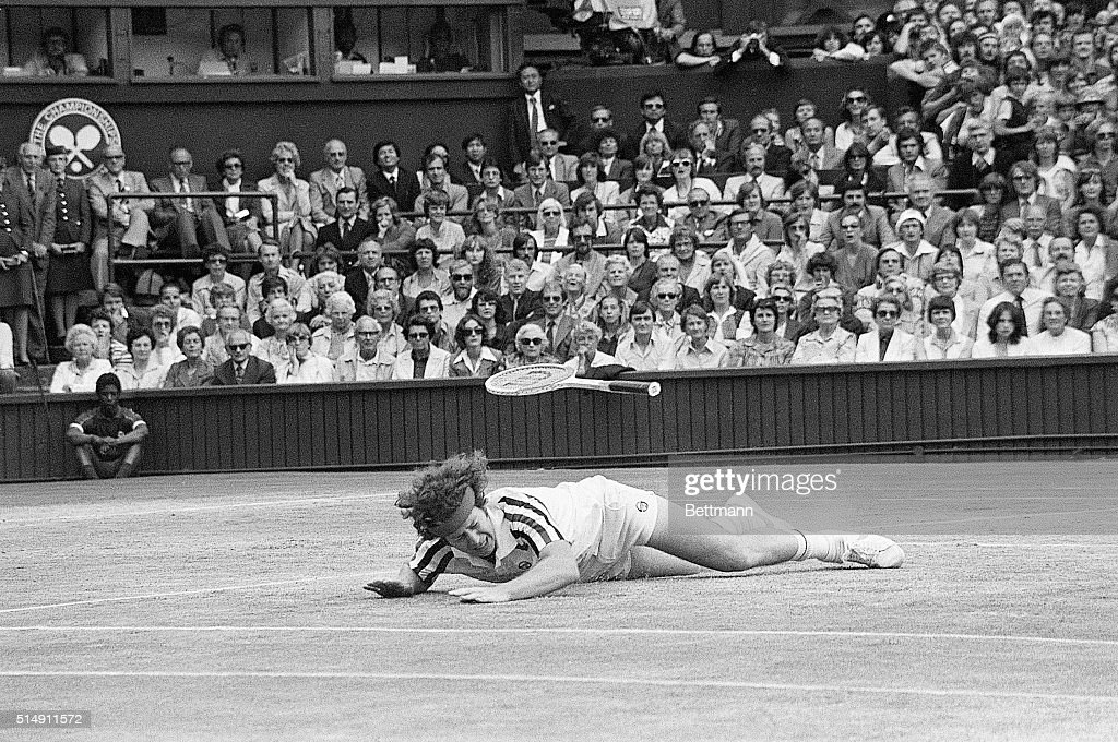The Men's Singles final. John McEnroe (USA) falls to the ground in a heavy fall and his racket goes flying, during his battle with Bjorn Borg of Sweden. Borg won the game 1-5, 7-5,6-3,6-7, 8-6, and took the title for the 5th consecutive time, a new record.