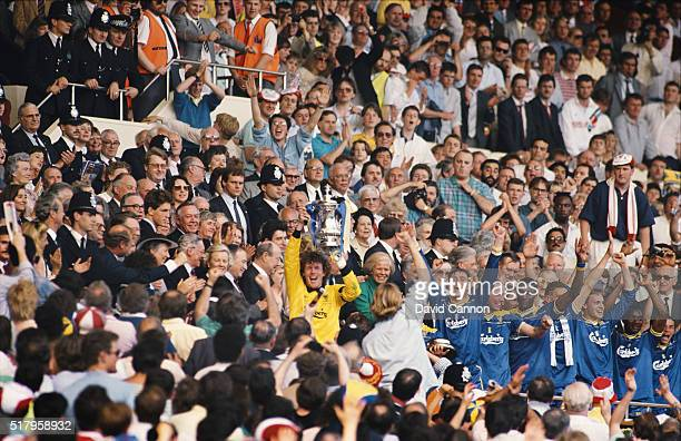 Wimbledon captain Dave Beasant lifts the FA Cup up from the royal box after beating Liverpool 10 in the 1988 FA Cup Final at Wembley Stadium on May...