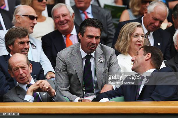 Wimbledon Chairman Philip Brook talks with former champion Michael Stitch while attending day one of the Wimbledon Lawn Tennis Championships at the...