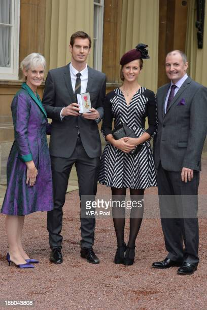 Wimbledon champion Andy Murray, his parents Judy and Will and his girlfriend Kim Sears pose at Buckingham Palace on October 17, 2013 in London,...