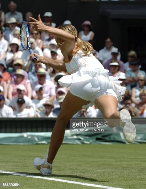 Wimbledon Champion Maria Sharapova of Russia in action during her first round match against Nuria Llagostera Vives of Spain
