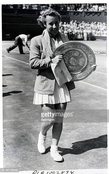 """Wimbledon, England: """"Little Mo"""" takes Wimbledon. 17 year old Maureen Connolly of San Diego, CA walks off with the Wimbledon court with her trophy,..."""