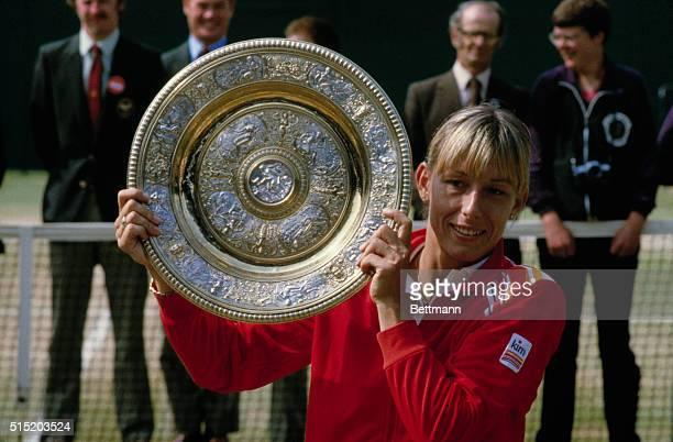 Wimbledon, England: Martina Navratilova lifts the Women's Singles Trophy after her victory at Wimbledon.