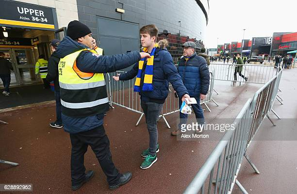 Wimbledon fans are searched as they enter the stadium prior to the Sky Bet League One match between Milton Keynes Dons and AFC Wimbledon at StadiumMK...