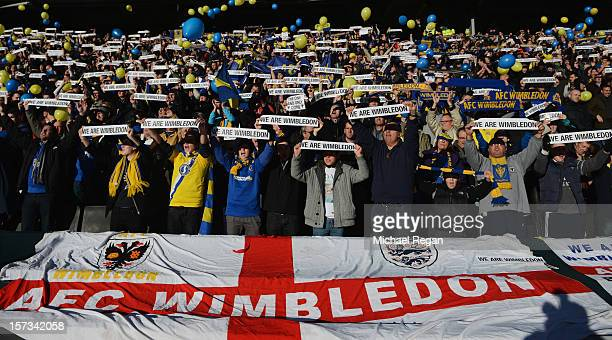 Wimbledon fans support their team prior to the FA Cup with Budweiser Second Round match between MK Dons and AFC Wimbledon at StadiumMK on December 2...