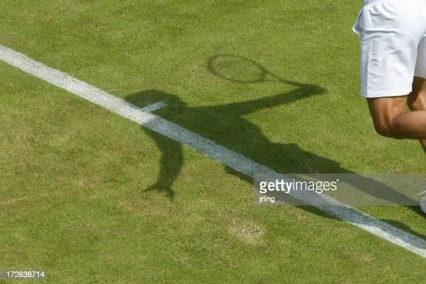 Wimbledon Grass Court Player Serving with shadow