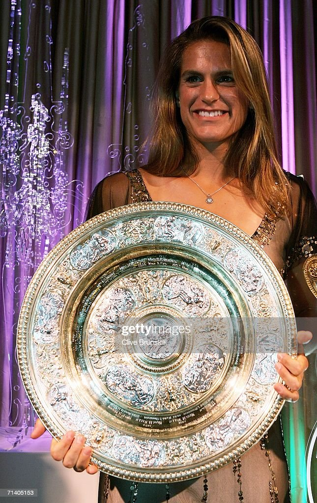 Wimbledon Ladies Singles Champion Amelie Mauresmo of France poses with her trophy at the Wimbledon Winners' Dinner at the Savoy Hotel on July 9, 2006 in London, England.