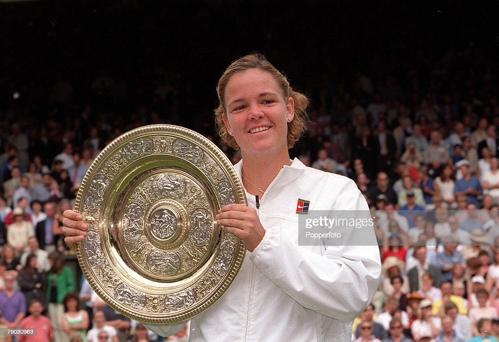 1999 Wimbledon Lawn Tennis Championships. Ladies Singles Final. USA's Lindsay Davenport holds the trophy after defeating Steffi Graf in the Final. : News Photo