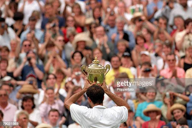 Wimbledon Lawn Tennis Championships Men's Singles Final USA's Pete Sampras shows off the trophy to the crowd after winning the title for the sixth...