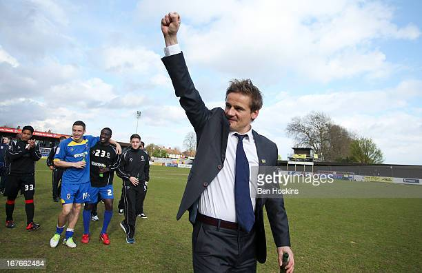 Wimbledon manager Neal Ardley celebrates after the npower League Two match between AFC Wimbledon and Fleetwood Town at the Cherry Red Records Stadium...