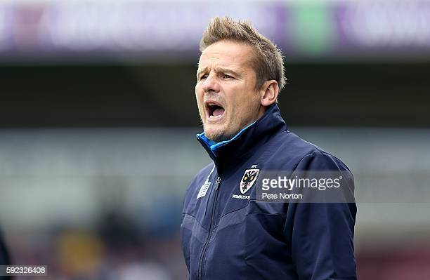 Wimbledon manager Neal Ardley looks on during the Sky Bet League One match between Northampton Town and AFC Wimbledon at Sixfields Stadium on August...