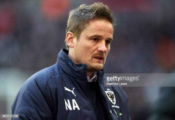 Wimbledon manager Neal Ardley looks on prior to The Emirates FA Cup Third Round match between Tottenham Hotspur and AFC Wimbledon at Wembley Stadium...