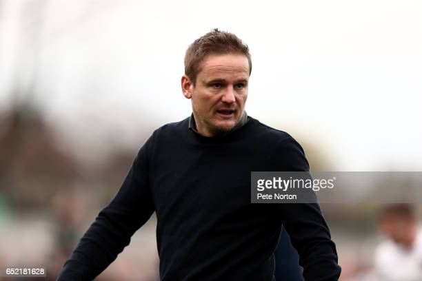 Wimbledon manager Neal Ardley walks from the pitch at the end of the Sky Bet League One match between AFC Wimbledon and Northampton Town at The...