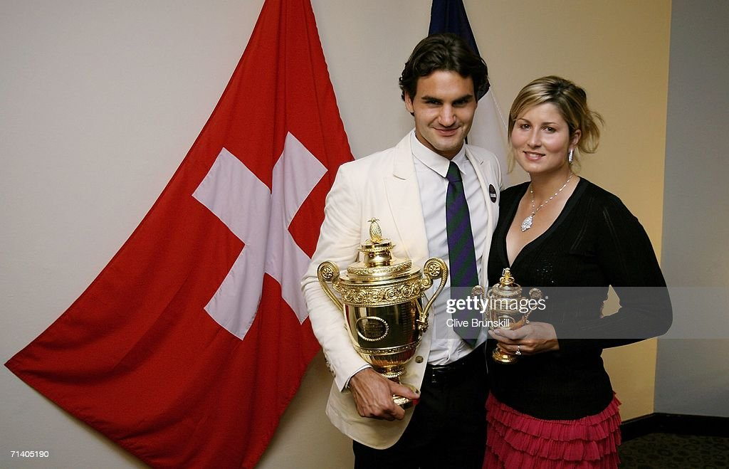 Wimbledon Mens Singles Champion Roger Federer of Switzerland poses with his trophy and girlfriend Mirka Vavrinec at the Wimbledon Winners' Dinner at the Savoy Hotel on July 9, 2006 in London, England.