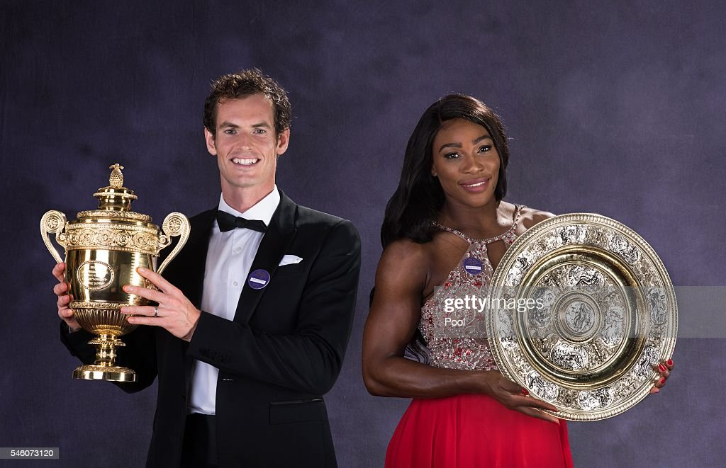 Wimbledon men's singles Tennis Champion Andy Murray of Great Britain and the ladies singles Tennis Champion Serena Williams of the United States pose with the trophies at the Wimbledon Champions Dinner 2016 at the Guild Hall on July 10, 2016 in London, England.