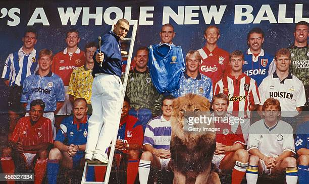 Wimbledon player Vinnie Jones nails a Wimbledon shirt to his image on a bill board promoting the first Premier League season in July 1992 Jones had...