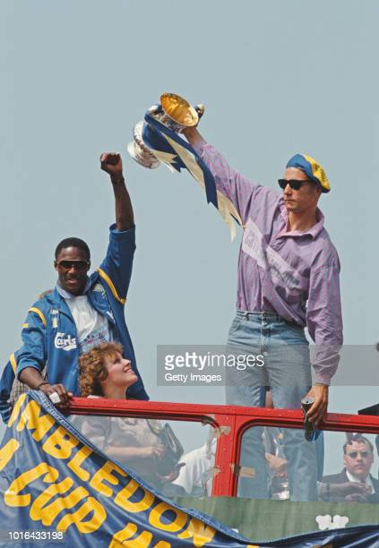 Wimbledon players John Fashanu and Vinnie Jones celebrate with the FA Cup Trophy on their open top bus parade after their famous 10 FA Cup Final win...