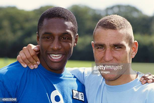 Wimbledon players John Fashanu and Vinnie Jones embrace after Jones had rejoined the club in 1992