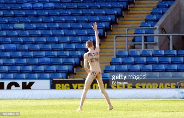 A Wimbledon supporter makes his feelings known about the clubs move to Milton Keynes during the Nationwide Division One game at Selhurst Park between...